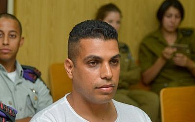 Former commander of the Tzabar battalion of the IDF Givati Brigade  Liran Hajabi (R) seen in court in Tel Aviv on July 2, 2015. (Flash90)