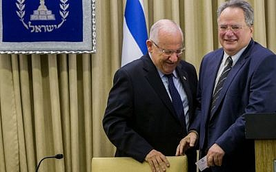 President Reuven Rivlin (L) meets with Greek Foreign Minister Nikolaos Kotzias (R), at the President's Residence in Jerusalem on July 7, 2015. (Yonatan Sindel/Flash90)