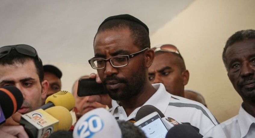 The brother of Avraham Mengistu speaks with the media at their home in Ashkelon, after a gag order was been lifted over Mengistu's disappearance in the Gaza Strip, on July 8, 2015. (Miriam Alster/Flash90)
