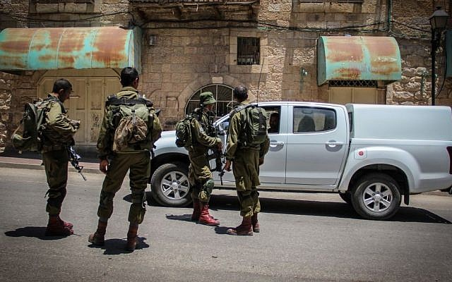 Israeli soldiers in the West Bank city of Hebron, on July 10, 2015. (Garrett Mills/Flash90)