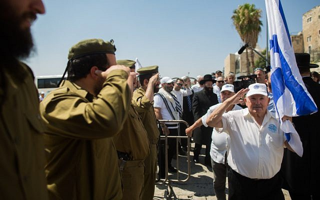 Holocaust survivors arrive to celebrate their belated bar mitzvah at the Western Wall, Judaism's holiest site, in Jerusalem's Old City on July 13, 2015. (Yonatan Sindel/Flash90)