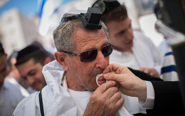 Holocaust survivors celebrate their belated bar mitzvah at the Western Wall, Judaism's holiest site, in Jerusalem's Old City on July 13, 2015.(Yonatan Sindel/Flash90)