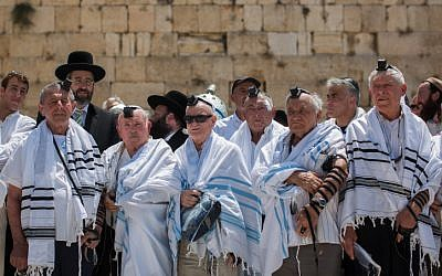 Holocaust survivors pose for a photo after celebrating their belated bar mitzvah at the Western Wall in Jerusalem's Old City, on July 13, 2015. (Yonatan Sindel/Flash90)