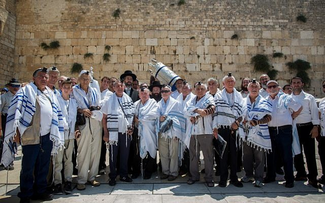 Holocaust survivors pose for a picture after celebrating their belated bar mitzvah at the Western Wall, Judaism's holiest site, in Jerusalem's Old City on July 13, 2015. (Yonatan Sindel/Flash90)