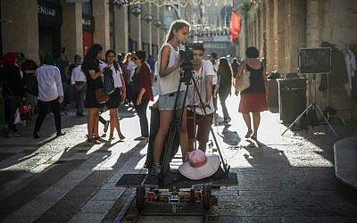 Young filmmakers work on a scene at the Mamilla Mall during the Jerusalem Film Festival, July 2015. (Hadas Parush)