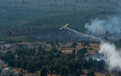 Illustrative photo of firefighter planes extinguishing a large fire near Kiryat Shmona, on July 19, 2015. (Basel Awidat/Flash90)