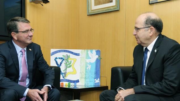 Israeli Defense Minister Moshe Ya'alon (right) meets with US Defense Secretary Ashton Carter (left) at the Ministry of Defense in Tel Aviv, on July 20, 2015. (Matty Stern/US Embassy Tel Aviv)