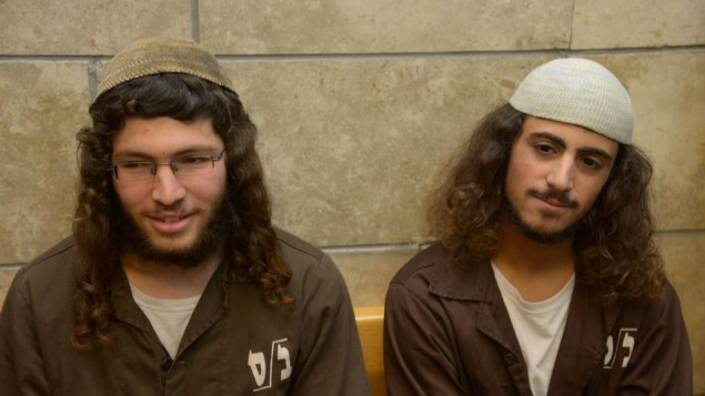 Yinon Reuveni (right) and Yehuda Asraf, suspected of vandalizing the church of the Multiplication of the Loaves and Fishes in Tabgha, on the shore of the Sea of Galilee, are seen at the Nazareth Magistrate's Court on July 29, 2015. (Photo by Basel Awidat/Flash90)