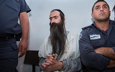 Yishai Schlissel, who stabbed six people at the annual Jerusalem Gay Pride Parade on July 30, 2015, is seen in the Jerusalem Magistrate's Court on July 31, 2015. (Yonatan Sindel/Flash90)
