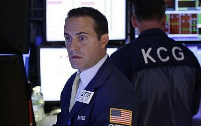 Traders work on the floor at the New York Stock Exchange in New York, Wednesday, July 8, 2015. (AP Photo/Seth Wenig)