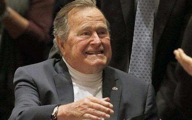 In this Nov. 11, 2014, file photo, former President George H.W. Bush acknowledges the crowd at his presidential library before his son former President George W. Bush discusses his new book '41: A Portrait of My Father' in College Station, Texas. (AP Photo/Texas Tribune, Bob Daemmrich, Pool)