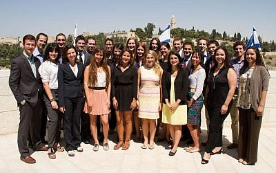 Participants in the Menachem Begin Heritage Center's Masa program, the Israel Government Fellows, stand on a balcony overlooking Jerusalem's Old City. (courtesy)