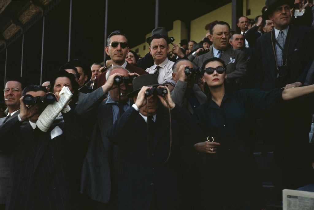 The 1952 photo by Robert Capa provided by the International Center of Photography/Magnum Photos shows spectators at the Longchamp Racecourse, Paris. (Robert Capa/International Center of Photography/Magnum Photos via AP)