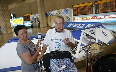 In a photo pixelated for security reasons, David and his wife arrive at Ben-Gurion Airport from Ukraine Wednesday, July 1, 2015. (Baz Ratner)