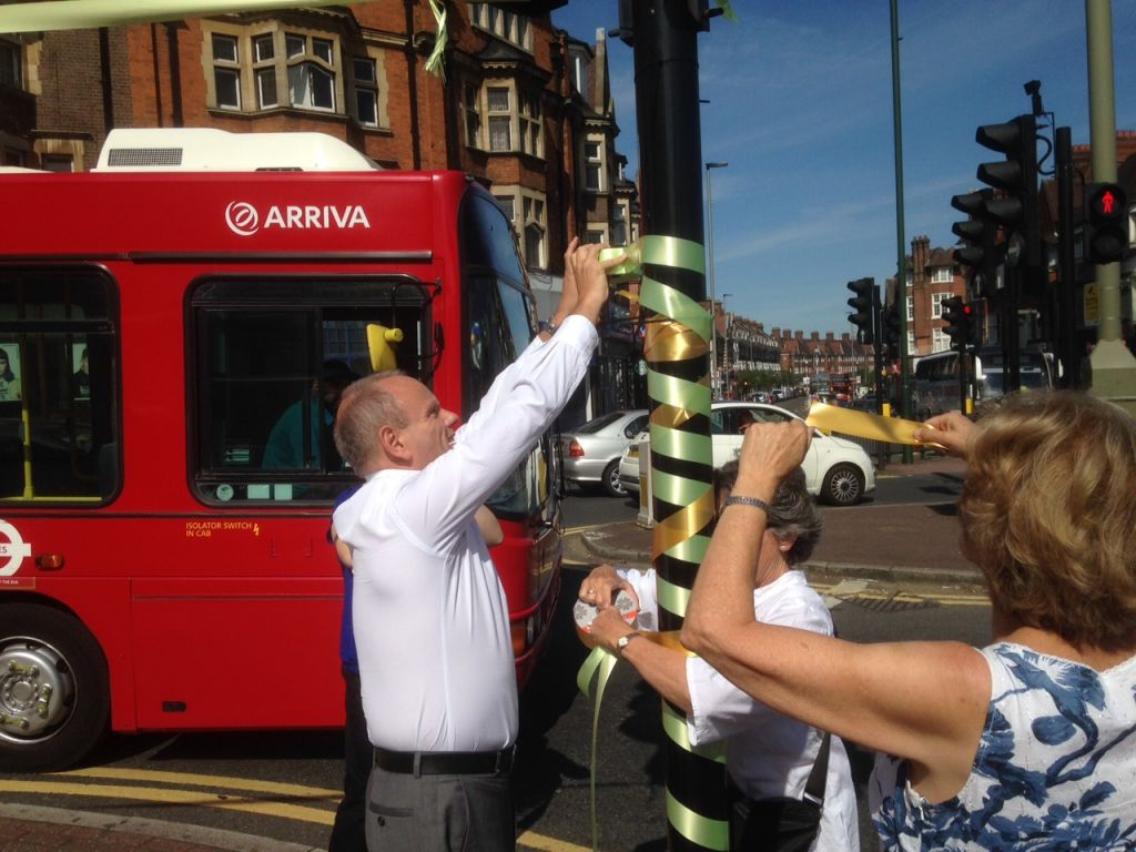 Golders Green MP Conservative Mike Freer (left) bedecks the neighborhood with gold and green for the Golders Green Together rally against a proposed neo-Nazi protest on July 3, 2015. (Jenni Frazer/The Times of Israel)