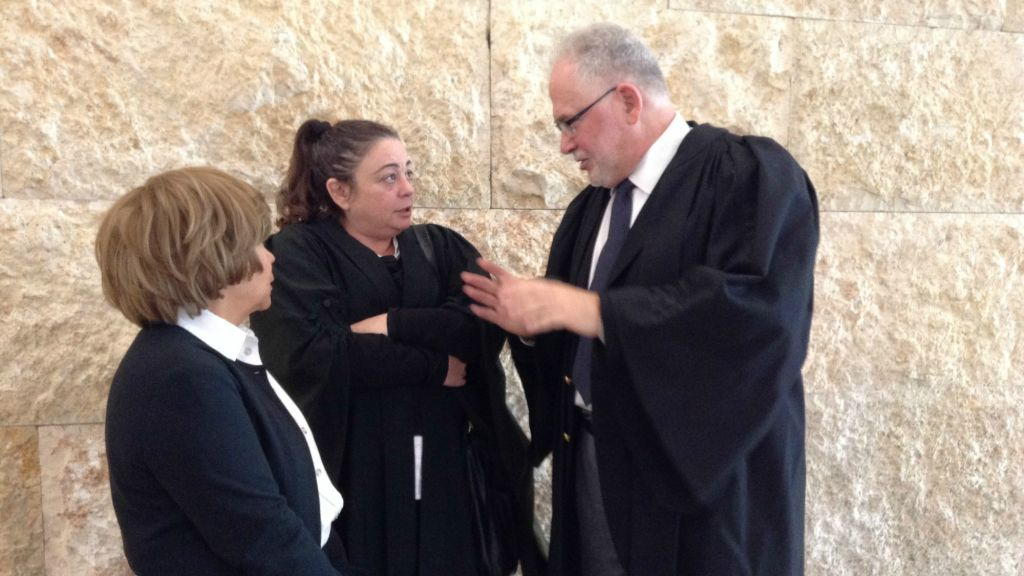 Lawyers Rabbi Uri Regev (far right) and Edna Meyrav with their client from Elad at a Supreme Court hearing in 2014. (courtesy Hiddush)