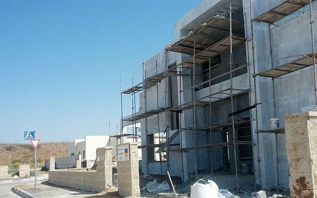 A house under construction in the town of Beer Ganim, which will hold nine communities evacuated from Gush Katif. Only about 170 out of the eventual 1000 families have finished their homes and are living in the town. (Melanie Lidman/Times of Israel)