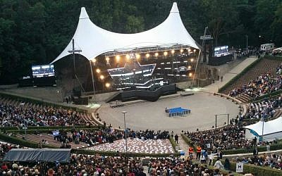 The opening ceremony of the European Maccabi Games in Berlin, a first since World War II, at the Waldbüche amphitheater, constructed for the 1936 Olympic Games and originally named for Adolf Hitler's mentor Dietrich Eckart, July 29, 2015. (Ilan Ben Zion)