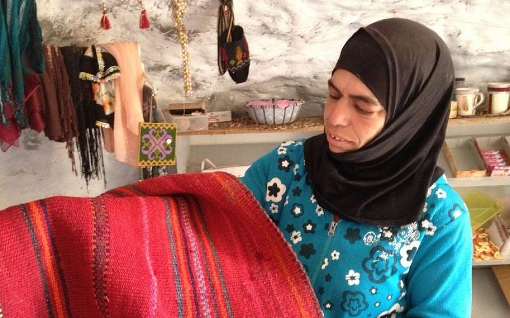 Widad Nawajah displays a rug woven locally in Susya, July 19, 2015 Elhanan Miller/Times of Israel