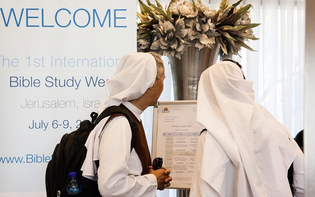 A pair of nuns on their way to the first International Bible Study Week in Jerusalem, July 6-9, 2015. (Dave Sinai)
