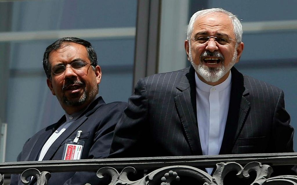 Iranian Foreign Minister Mohammad Javad Zarif (right), talks to a journalist from a balcony of the Palais Coburg Hotel in Vienna, Austria, on July 10, 2015. (Carlos Barria/Pool via AP)