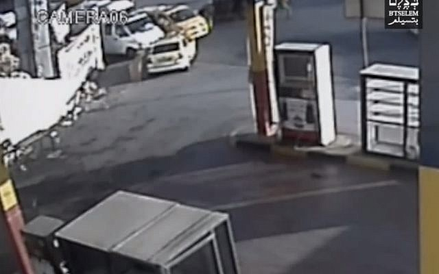 Security camera footage which claims to show Col. Yisrael Shomer firing at Muhammad al-Kasbeh (screen capture: YouTube, B'Tselem)