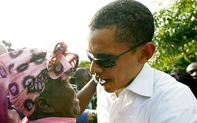 In this Saturday, Aug. 26, 2006 file photo, then US Senator Barack Obama meets with his step-grandmother Sarah Obama at his father's house in Kogelo, western Kenya. (AP Photo/Sayyid Azim, File)
