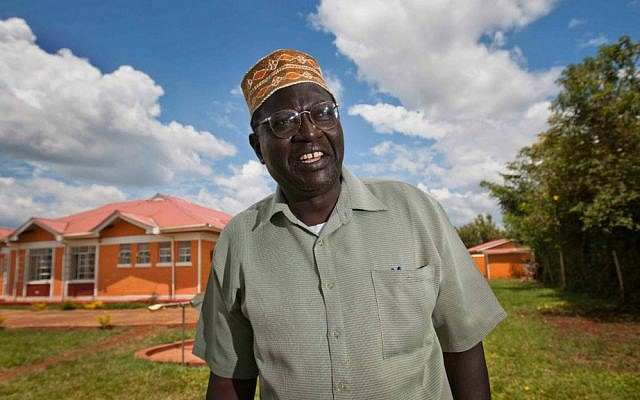 In this Sunday, Nov. 4, 2012 file photo, Malik Obama, half-brother of President Barack Obama, poses for photographs after speaking about the then upcoming US elections to a reporter in the village of Kogelo where he lives in western Kenya. (AP Photo/Ben Curtis, File)
