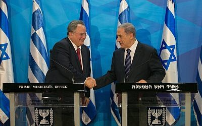 Prime Minister Benjamin Netanyahu (right) shakes hands with Greek Foreign Minister Nikos Kotzias during a joint press conference at the Prime Minister's Office in Jerusalem, July 6, 2015. (Ohad Zwigenberg/Flash90/Pool)