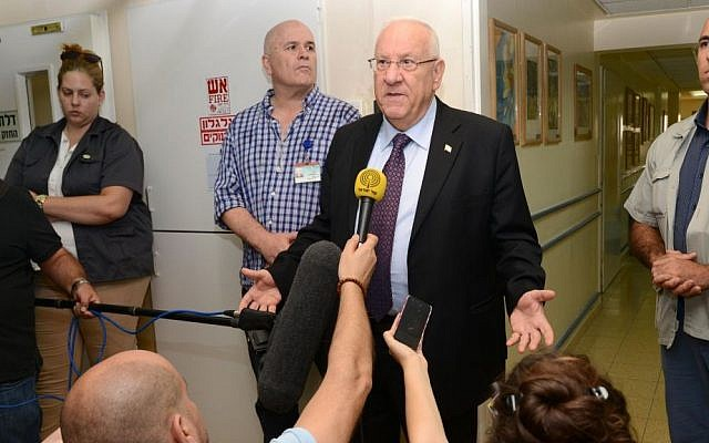 President Reuven Rivlin speaks to the press after visiting Ahmed Dawabsha at Sheba Medical Center in Tel Hashomer on Friday, July 31, 2015. (Mark Neyman/GPO)