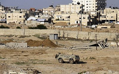 In this Nov. 6, 2014, file photo, an Egyptian armored vehicle is seen on the Egyptian side of the border across from Rafah in north Sinai. (Ahmed Abd El Latif, El Shorouk Newspaper/AP)