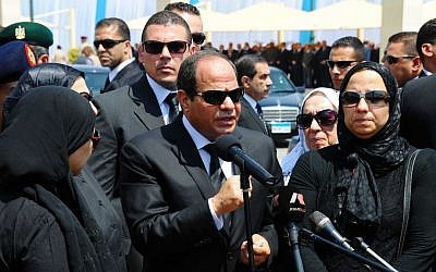 Egyptian President Abdel-Fattah el-Sissi, center, speaks at the funeral of the top public prosecutor Hisham Barakat, killed in a terrorist attack, June 30, 2015. (Egyptian Presidency via AP, File)