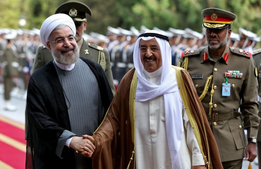 File: Kuwait's emir, Sheikh Sabah Al Ahmad Al Sabah, right, shakes hands with Iranian President Hassan Rouhani during a reception ceremony at the Saadabad Palace in Tehran, Iran, June 1, 2014 (AP/Ebrahim Noroozi, File)
