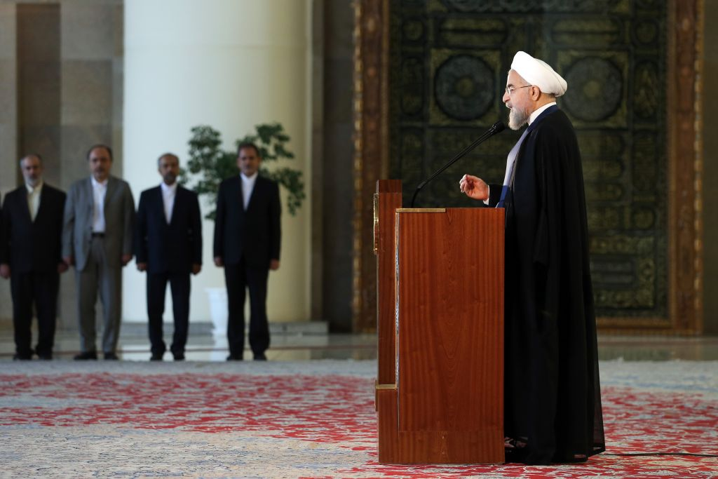 Iran's President Hassan Rouhani addresses the nation in a televised speech minutes after a landmark nuclear agreement was announced in Vienna, in Tehran, Iran, Tuesday, July 14, 2015. (AP Photo/Ebrahim Noroozi)