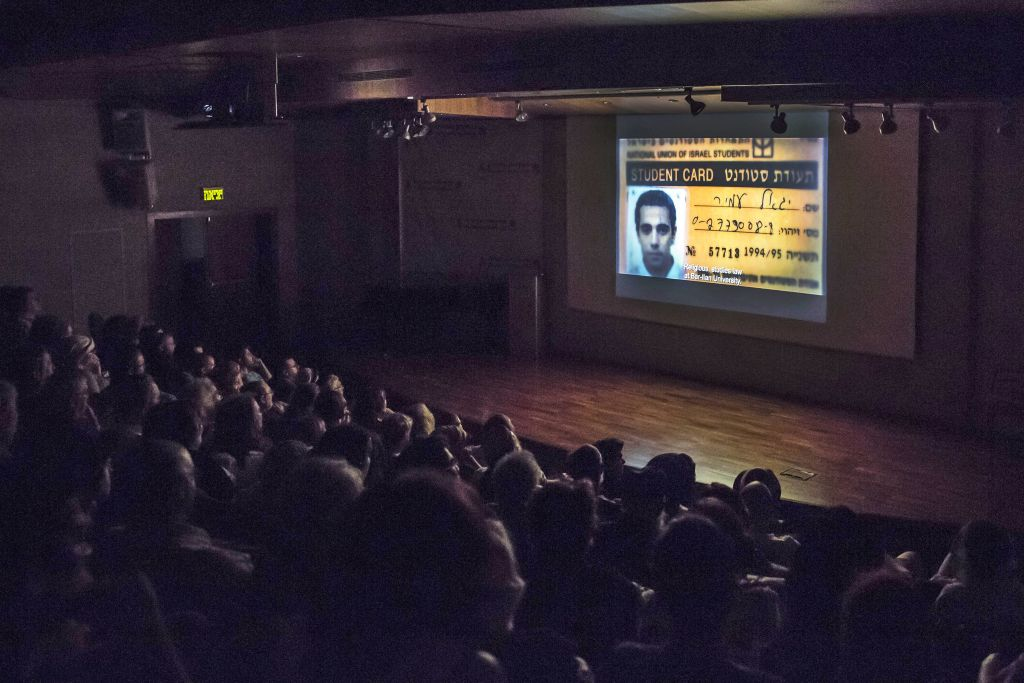 "In this photo taken Wednesday, July 8, 2015, the student card of Yigal Amir, who assassinated Israeli Prime Minister Yitzhak Rabin, is seen during a screening of ""Beyond the Fear"" movie in Jerusalem. (AP Photo/Tsafrir Abayov)"