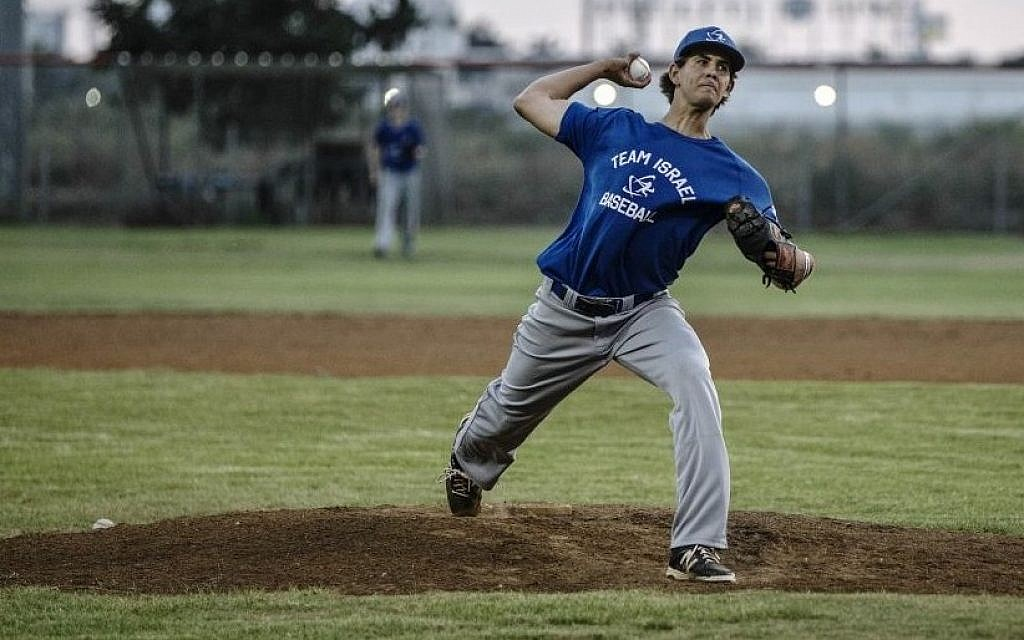 In this Monday, July 20, 2015 photo, Israel baseball team pitcher Dean Kremer pitches during training near the city of Petah Tikva, Israel. (AP/Tsafrir Abayov)