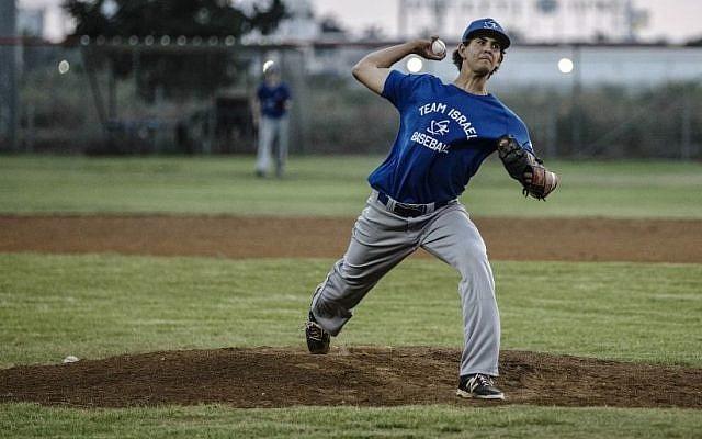 In this Monday, July 20, 2015 photo, Israel baseball team pitcher Dean Kremer pitches during training near the city of Petah Tikva, Israel. (AP/Tsafrir Abayov)