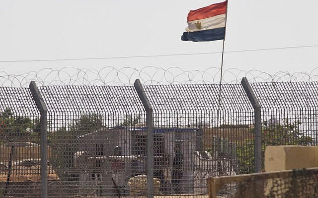 An Egyptian military officer watches at a post in Egypt's northern Sinai Peninsula, as seen from the Israel-Egypt border on Wednesday, July 1, 2015. (AP/Ariel Schalit)