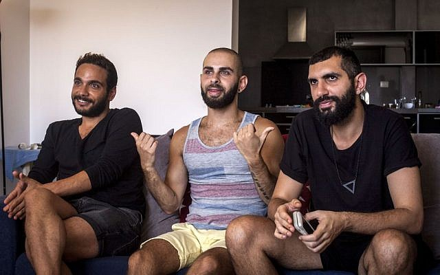 "This Monday, July 27, 2015 photo shows Khader Abu Seif, from left, Naeem Jiryes and Fadi Daeem, protagonists of the documentary movie ""Oriented"" during an interview with The Associated Press in Jaffa.  (AP Photo/Eyal Warshavsky)"