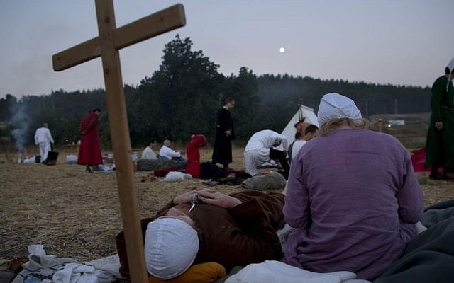 Israeli and Russian members of knight clubs wearing medieval costumes wait in their camp (AP/Oded Balilty)
