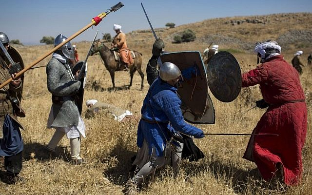 Israeli and Russian members of knight clubs participate in the reenactment of the Battle of Hattin in the Horns of Hattin, northern Israel, July 4, 2015 (AP/Oded Balilty)
