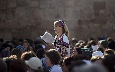 In this Monday, Nov. 4, 2013, file photo, a Jewish woman wears a prayer shawl as she prays at the Western Wall, the holiest site where Jews can pray in Jerusalem's Old City. (AP Photo/Ariel Schalit, File)