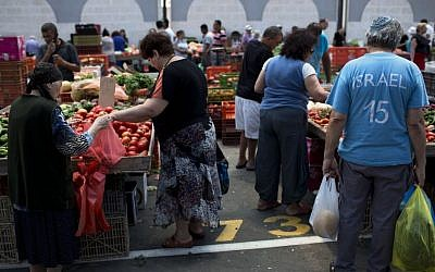 In this Tuesday, June 23, 2015 photo, Israelis buy groceries in an open market in the southern Israeli town of Sderot, next to the Israel-Gaza border. (Oded Balilty/AP)