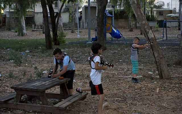 In this Monday, June 22, 2015 photo, Israeli youth play with laser guns in the southern Israeli town of Sderot, next to the Israel-Gaza border. (Oded Balilty/AP)