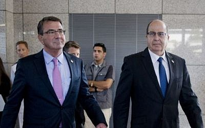 US Defense Secretary Ashton Carter (left), and Israeli Defense Minister Moshe Ya'alon (right) arrive for their joint news conference at the headquarters of the Israel Defense Forces in Tel Aviv on July 20, 2015. (AP/Carolyn Kaster, Pool)