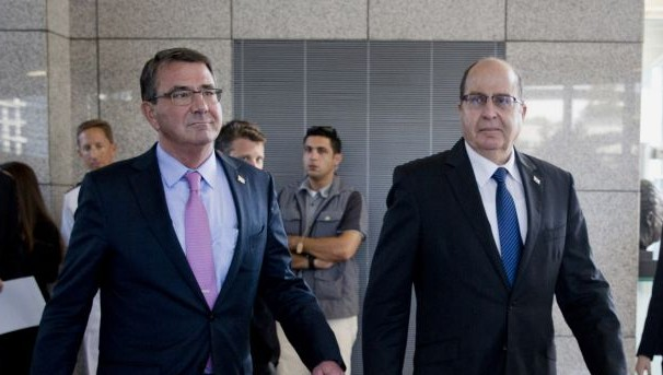 US Defense Secretary Ash Carter, left, and Israeli Defense Minister Moshe Ya'alon arrive for their joint news conference at Israel's Defense Force headquarters in Tel Aviv, Israel, Monday, July 20, 2015. (AP Photo/Carolyn Kaster, Pool)