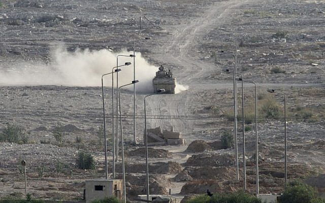 An Egyptian military personnel carrier patrols on the Egyptian side of the border between Egypt and Rafah in the southern Gaza Strip, Wednesday, July 1, 2015 (AP/Mohammed Ebaid)
