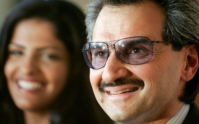In this Tuesday, Sept. 4, 2007 file photo, Saudi Arabia's Prince Alwaleed bin Talal, foreground, delivers a speech as his wife, Princess Amira, looks on, after he received the medal of Great Patron of the French Culture Ministry during a ceremony at the Louvre museum in Paris, France. (AP Photo/Francois Mori, File)