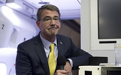 US Defense Secretary Ash Carter pauses as he speaks with media on a military aircraft on Wednesday, July 22, 2015. (AP/Carolyn Kaster, Pool)