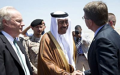 US Defense Secretary Ashton Carter, right, is greeted by Saudi Arabian Assistant Minister of Defense Mohammad Al-Ayesh, center, after his arrival in Jeddah, Saudi Arabia, July 22, 2015. (Carolyn Kaster/AP/Pool)